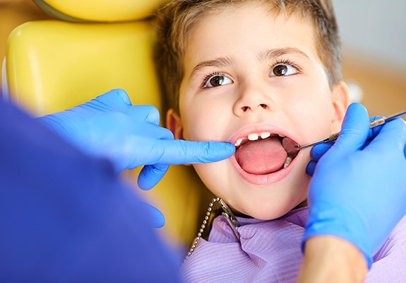Child receiving dental exam