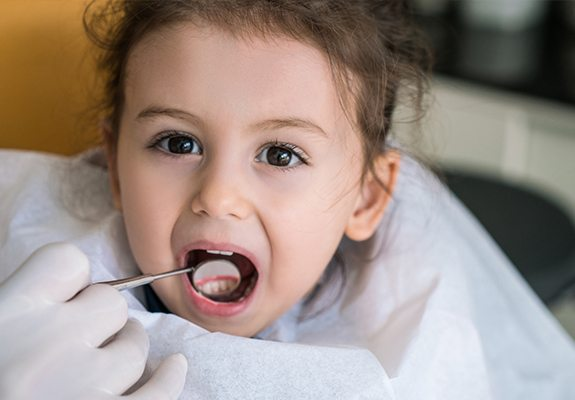Little girl receiving dental treatment