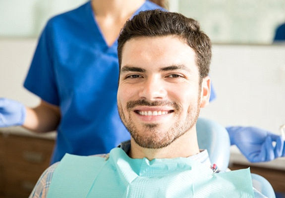Smiling male patient at dentist's