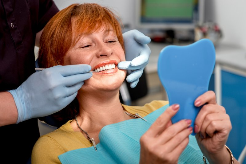 Woman with dental implants in Fanwood